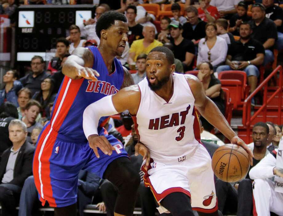 Miami Heat guard Dwyane Wade (3) drives past Detroit Pistons guard Kentavious Caldwell-Pope trails during the first half of an NBA basketball game, Sunday, March 29, 2015, in Miami. (AP Photo/Joe Skipper) Photo: Joe Skipper, FRE / FR171174 AP