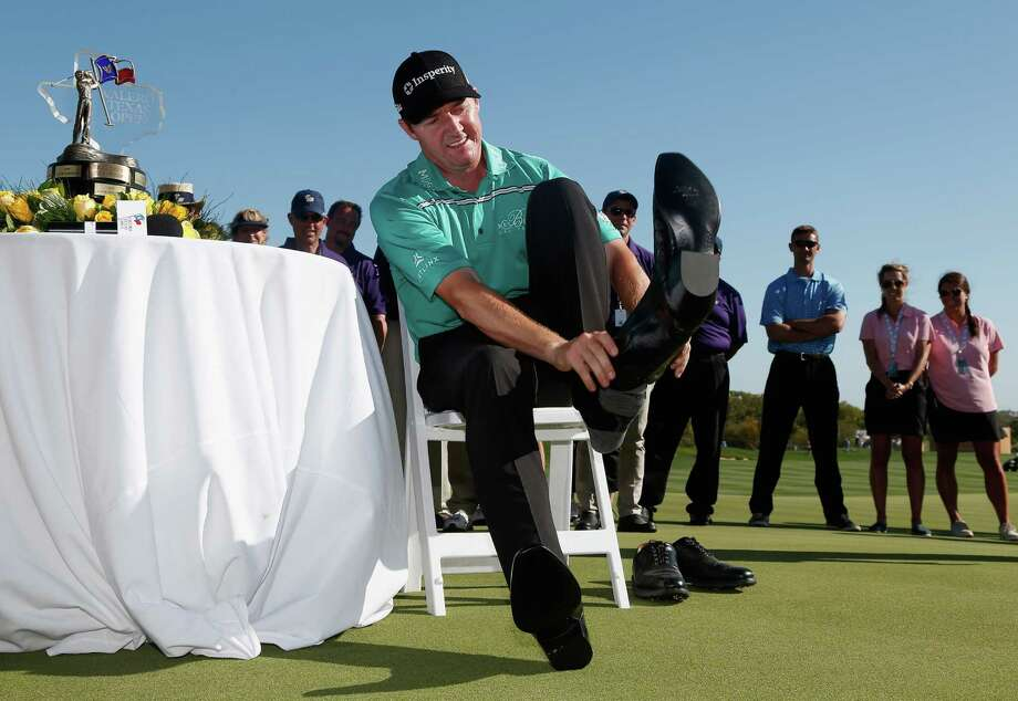Being a resident of Boerne, Jimmy Walker should feel at home with the cowboy boots he won for his four-stroke victory Sunday in San Antonio. Photo: Christian Petersen, Staff / 2015 Getty Images