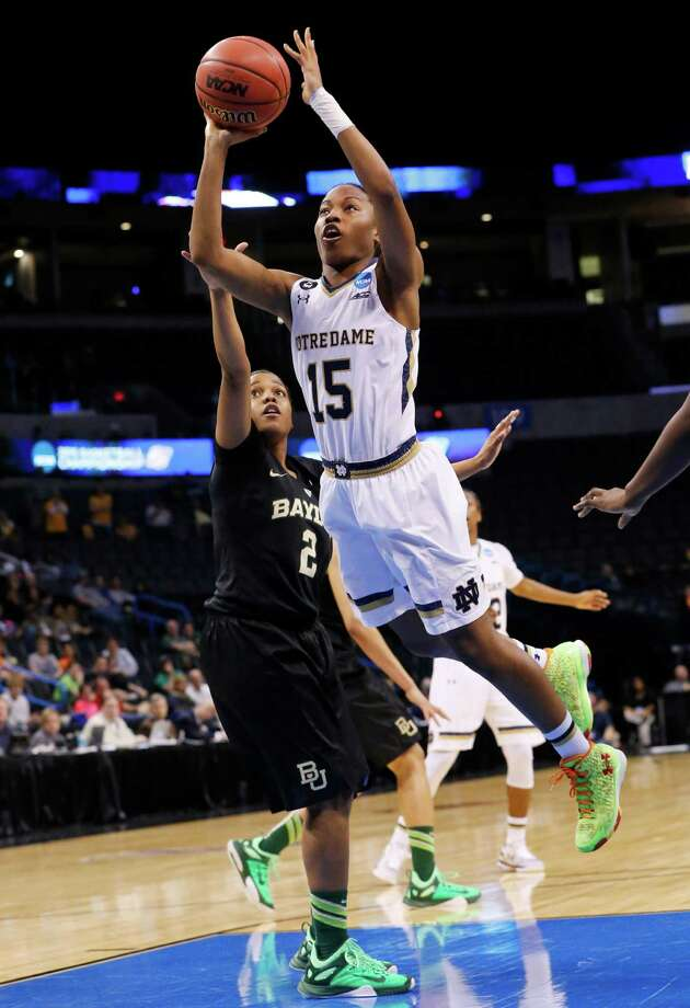Notre Dame guard Lindsay Allen (15) shoots as Baylor guard Niya Johnson (2) defends during the second half of a regional final in the NCAA women's college basketball tournament, Sunday, March 29, 2015, in Oklahoma City. Notre Dame won 77-68. (AP Photo/Sue Ogrocki) Photo: Sue Ogrocki, STF / AP