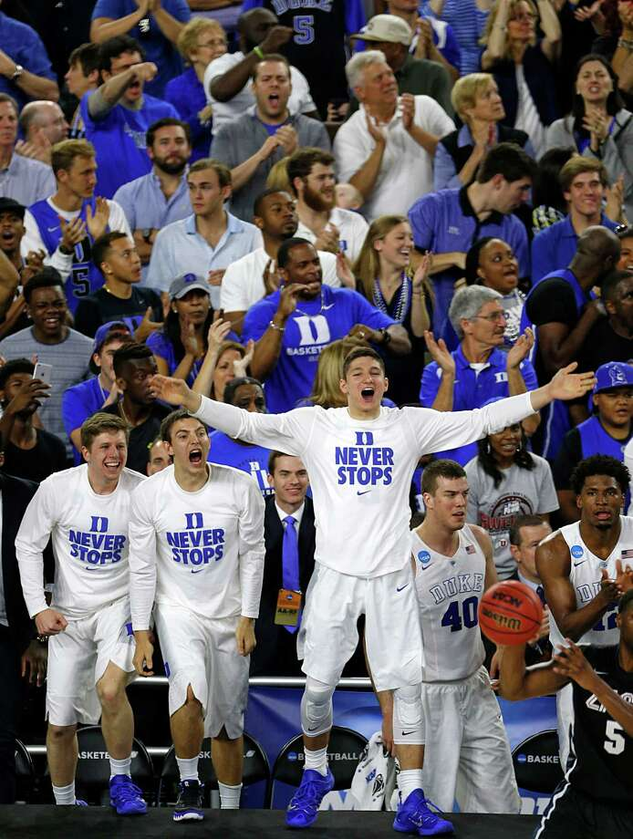 Guard Grayson Allen, center, leads the cheering section as Duke wins a regional in Houston to advance to Indianapolis, the scenario when the school won its last national title in 2010. Photo: James Nielsen, Staff / © 2015  Houston Chronicle