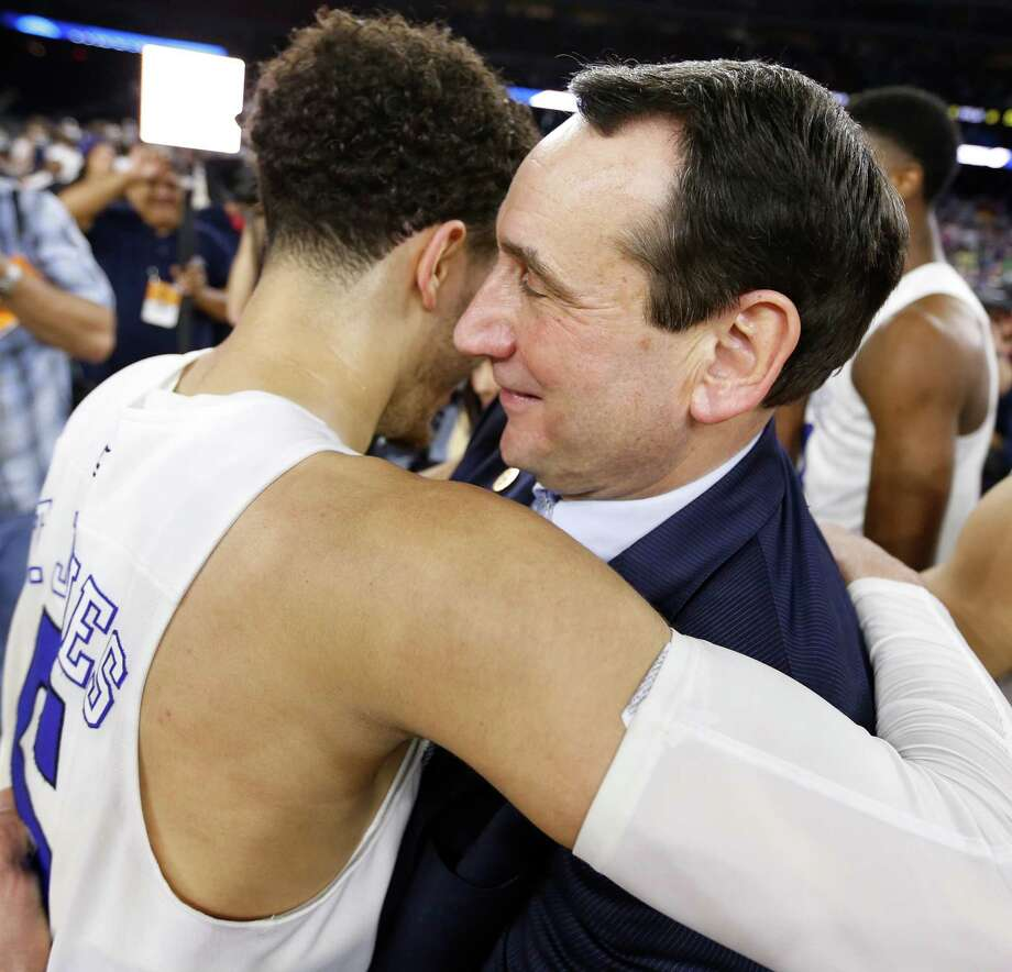 Duke guard Tyus Jones (5) and Duke head coach Mike Krzyzewski celebrate after victory in the NCAA South Regional final on Sunday, March 29, 2015, in Houston.  ( Karen Warren / Houston Chronicle  ) Photo: Karen Warren, Staff / © 2015 Houston Chronicle