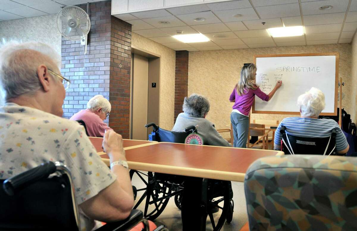 Tina Reese leads a word game for residents at a nursing home in Lancaster, Pa. Life insurance firms pitched long-term-care policies as the prudent way for Americans to shoulder the cost of staying in nursing homes. But those same companies have found that long-term-care policies are squeezing their profits.