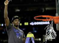 Duke's Justise Winslow holds part of the net after a college basketball regional final game against Gonzaga in the NCAA Tournament Sunday, March 29, 2015, in Houston. Duke won 66-52 to advance to the Final Four. (AP Photo/David J. Phillip)  ORG XMIT: TXMG180