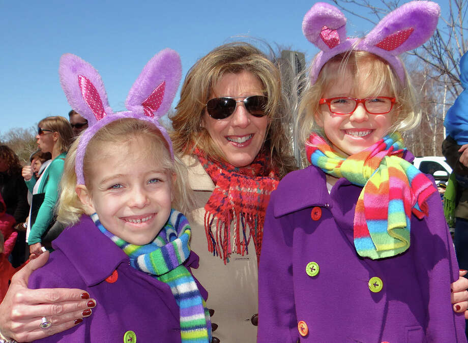 Bettina Cooleen and twin 7-year-old daughters, Caleigh and Cameron, wait on line for the town's annual egg hunt at the Fairfield Recreation Center early Sunday afternoon Photo: Mike Lauterborn / Fairfield Citizen