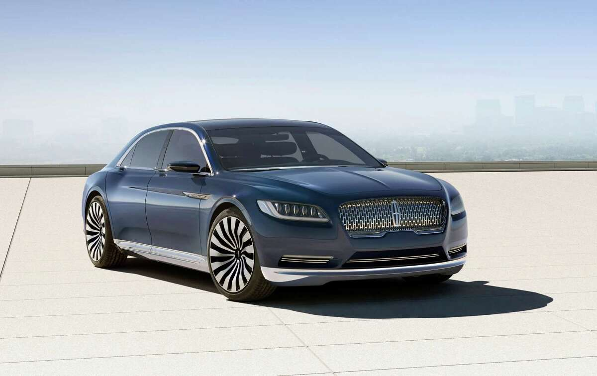 This product image provided by the Ford Motor Co. shows the new Lincoln Continental concept. Thirteen years after the last Continental rolled off a Michigan assembly line, Ford Motor Co. is debuting the new Continental in concept form at the New York Auto Show on Monday, March 30, 2015.The production version goes on sale next year.