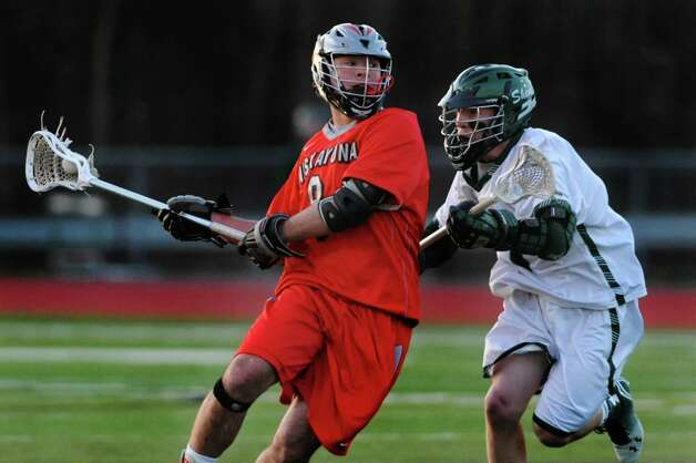 Niskayuna's Aidan O'Brien, left, carries the ball as Shen's Willy Stevenson defends during their lacrosse game on Thursday, April 24, 2014, at Shenendehowa High in Clifton Park, N.Y. (Cindy Schultz / Times Union) Photo: Cindy Schultz / 00026551A