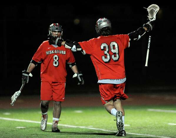 Niskayuna's Mike D'Amario, right, celebrates a goal with teammate Aidan O'Brien during their lacrosse game against Shen on Thursday, April 24, 2014, at Shenendehowa High in Clifton Park, N.Y. (Cindy Schultz / Times Union) Photo: Cindy Schultz / 00026551A