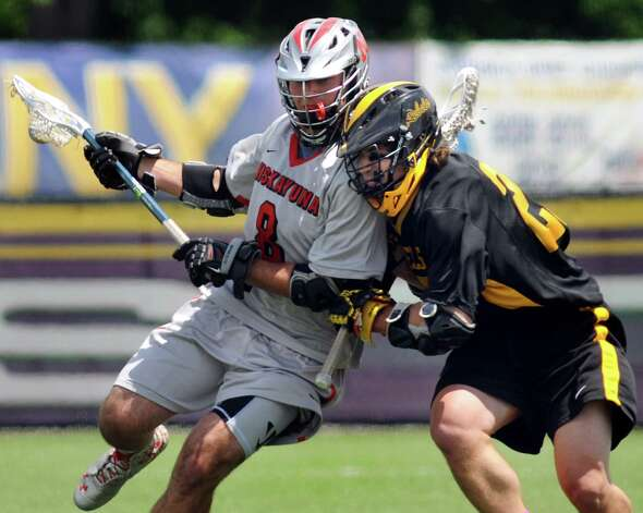 Niskayuna's Aidan O'Brien, left, controls the ball as Lakeland-Panas' Jimmy Flaherty defends during their Class A lacrosse regional final on Saturday, May 31, 2014, at UAlbany's John Fallon Field in Albany, N.Y. (Cindy Schultz / Times Union) Photo: Cindy Schultz / 00027091A