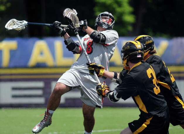 Niskayuna's Aidan O'Brien, left, shoots and scores during their Class A lacrosse regional final against Lakeland-Panas on Saturday, May 31, 2014, at UAlbany's John Fallon Field in Albany, N.Y. (Cindy Schultz / Times Union) Photo: Cindy Schultz / 00027091A