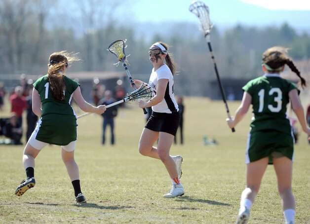 Bethlehem's Kaylee Rickert (#20), center, looks for an open teammate during their girls' lacrosse game against Shenendehowa on Thursday April 10, 2014 in Delmar, N.Y. (Michael P. Farrell/Times Union) Photo: Michael P. Farrell / 00026444A