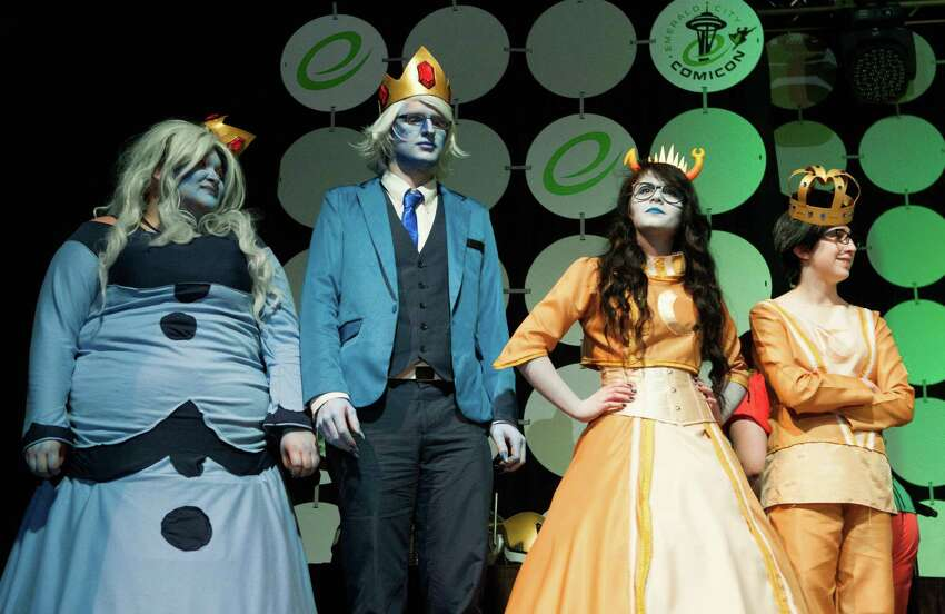 Contestants in the duo category line up onstage during day two of Emerald City Comicon at the Washington State Convention Center on Saturday, March 28, 2015. The three day convention is the largest comic book and pop culture convention in the Pacific Northwest. The convention features cosplay, comic books, celebrities and more.