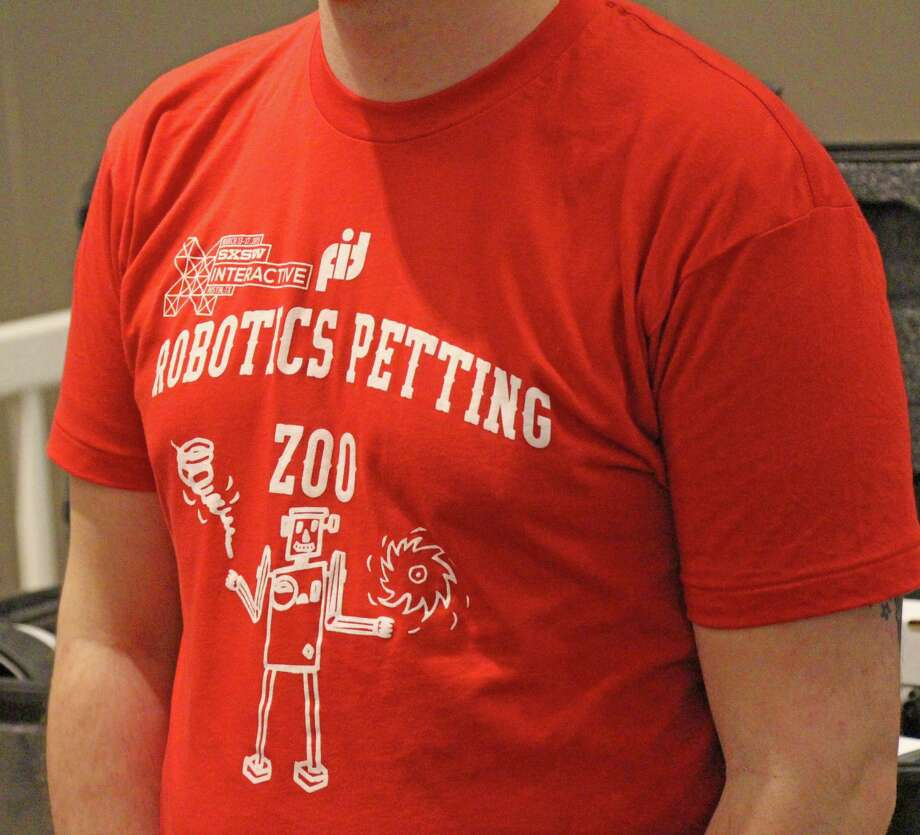 """At the SXSW technology trade show in Austin, Tex,, T-shirts promoted a """"robotics petting zoo"""" put together by an organization that helps with multiple aspects of disaster recovery.Austin, Tex. March 2015. Photo: Westport News/Contributed Photo / Westport News"""
