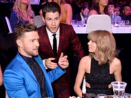 Entertainer Justin Timberlake, singer Nick Jonas and singer Taylor Swfit attend the 2015 iHeartRadio Music Awards which broadcasted live on NBC from The Shrine Auditorium on March 29, 2015 in Los Angeles, California. (Photo by Kevin Mazur/Getty Images for iHeartMedia)