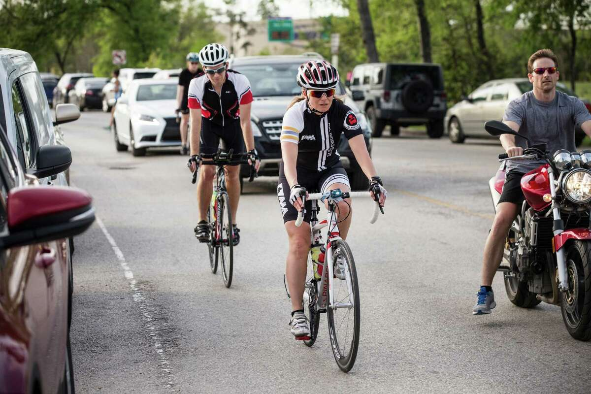 Cyclists ride through Memorial Park on Wednesday. Residents in nearby neighborhoods like the idea of an enhanced park but fret about increased traffic and danger to pedestrians and others.