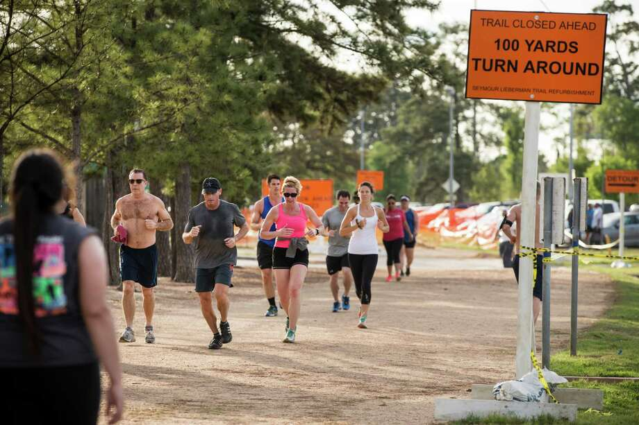 Joggers make their way along Memorial Park's Seymour Lieberman Exer-Trail, which is being renovated. Photo: Brett Coomer, Staff / © 2015 Houston Chronicle