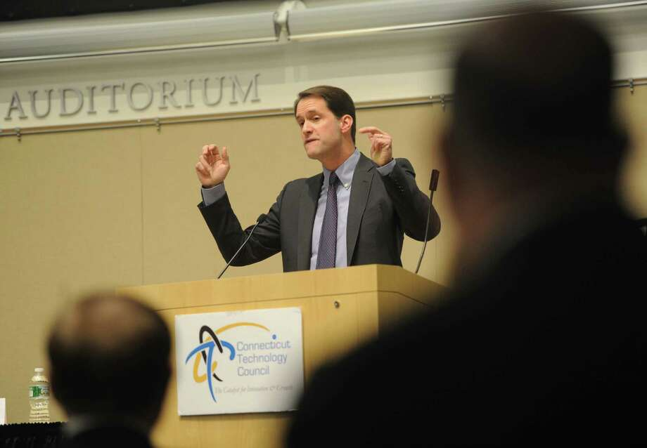 U.S. Rep. Jim Himes speaks during the cybersecurity seminar series at UConn Stamford branch in Stamford, Conn. Monday, March 30, 2015.  The Connecticut Technology Council hosted a cybersecurity forum featuring keynote speaker Congressman Jim Himes, a ranking member of the subcommittee for National Security Agency & Cybersecurity.  Connecticut Technology Council board member Rick Harris and FBI Supervisory Special Agent Martin McBride also spoke about cybersecurity. Photo: Tyler Sizemore / Greenwich Time