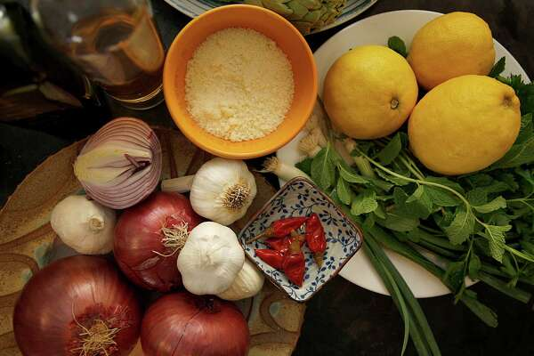 Spring produce goes into a quick-cooking braised lamb dish from chef Massimiliano Conti in San Francisco, California on Monday,March 2, 2015.