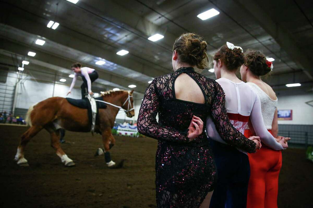Members of the Warm Beach Vaulter watch teammate Kaylee Evans perform during selection trials for the World Equestrian Games and International Vaulting Championships at the Lynden Fairgrounds on Saturday, March 28, 2015. The equestrian sport of vaulting dates back to Roman times when it was used to train cavalry riders for warfare. Modern vaulting is stylized and more similar to gymnastics and dance on the back of a moving horse.