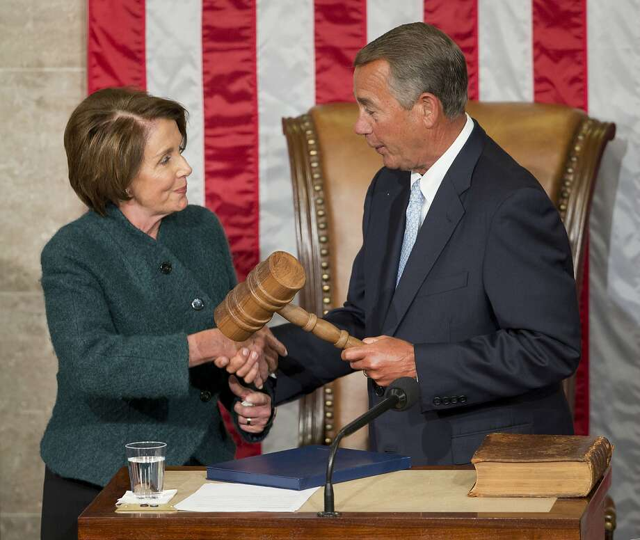 In this Jan. 6, 2015 file photo, House Speaker John Boehner of Ohio is handed the gavel from House Minority Leader Nancy Pelosi, D-Calif, after being re-elected for a third term to lead the 114th Congress, as Republicans assume full control for the first time in eight years, on Capitol Hill in Washington. Photo: Pablo Martinez Monsivais, Associated Press