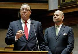Indiana Senate President Pro Tem David Long (left) and House Speaker Brian C. Bosma R-Indianapolis discuss their plans for clarifying the Indiana Religious Freedom Restoration Act during a news conference at the Statehouse in Indianapolis.