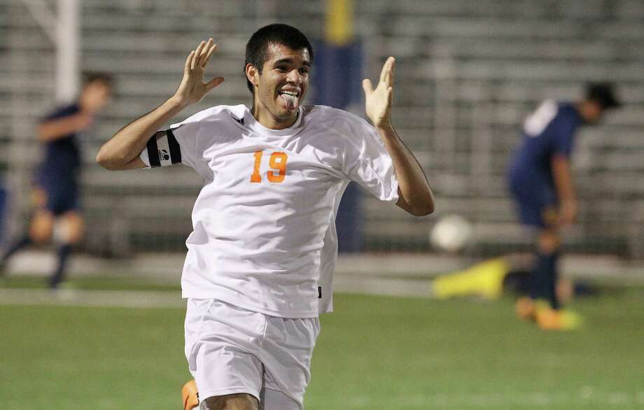 Brandeis' Patricio Botello celebrates after scoring his second goal against O'Connor in the second half of their Region IV quarterfinal soccer game at Farris Stadium in 2014. Photo: Kin Man Hui /San Antonio Express-News / ©2014 San Antonio Express-News