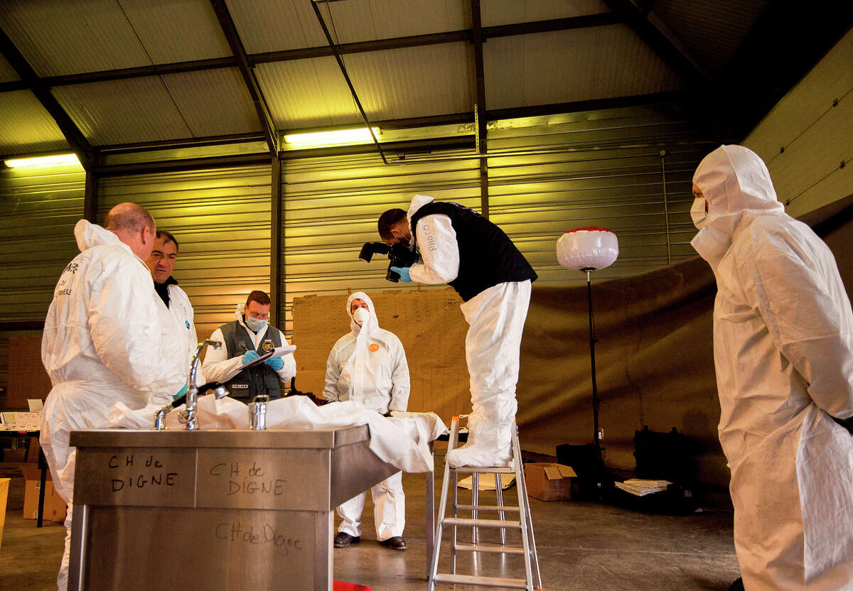 French forensic experts work to identify victims near the site of the plane crash in the French Alps.
