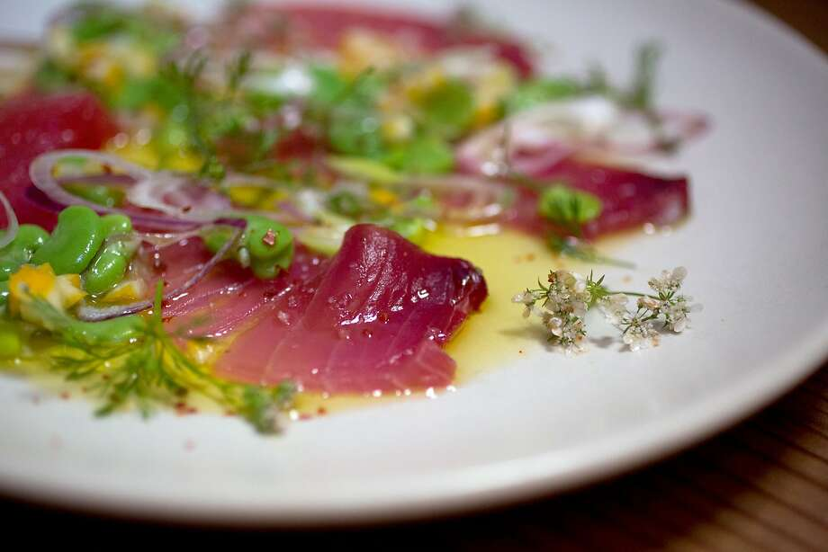 This is the yellowfinn tuna crudo with yara beans, meyer lemon and flowering cilantro photographed at Pizzaiolo in Oakland, Calif., Saturday March 28, 2015. Photo: Randi Lynn Beach, Special To The Chronicle
