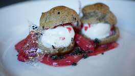 This is the buckwheat profiteroles with vanilla frozen yogurt, roasted strawberries and black sesame photographed at Range in San Francisco Calif., Friday March 27, 2015.