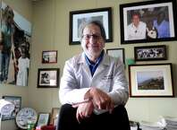 Dr. Majid Sadigh, director of Global health for Western Connecticut Health Network, is running a clinical trial for a vaccine to prevent infections from Clostridium difficile, a germ that sickens thousands of people in the U.S. His site is one of 200 nationwide, but only two in Connecticut. The  other is in Bristol. He is photographed in his Danbury Hospital office Monday, March 30, 2015.
