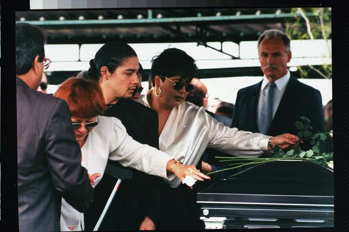 3. Selena was fatally shot The Tejano singer's death still rings in San Antonio today. In this photo, Selena's mother Marcela Quintanilla, husband Chris Perez and sister SuzetteQuintanillalay roses atop her casket at her funeral onApril 3, 1995.