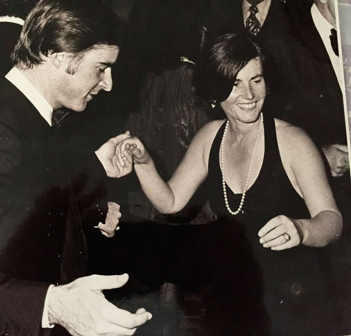 Cynthia Brown Kelly (right) and her brother, Gov. Jerry Brown, dance at a fundraiser in the '70s.
