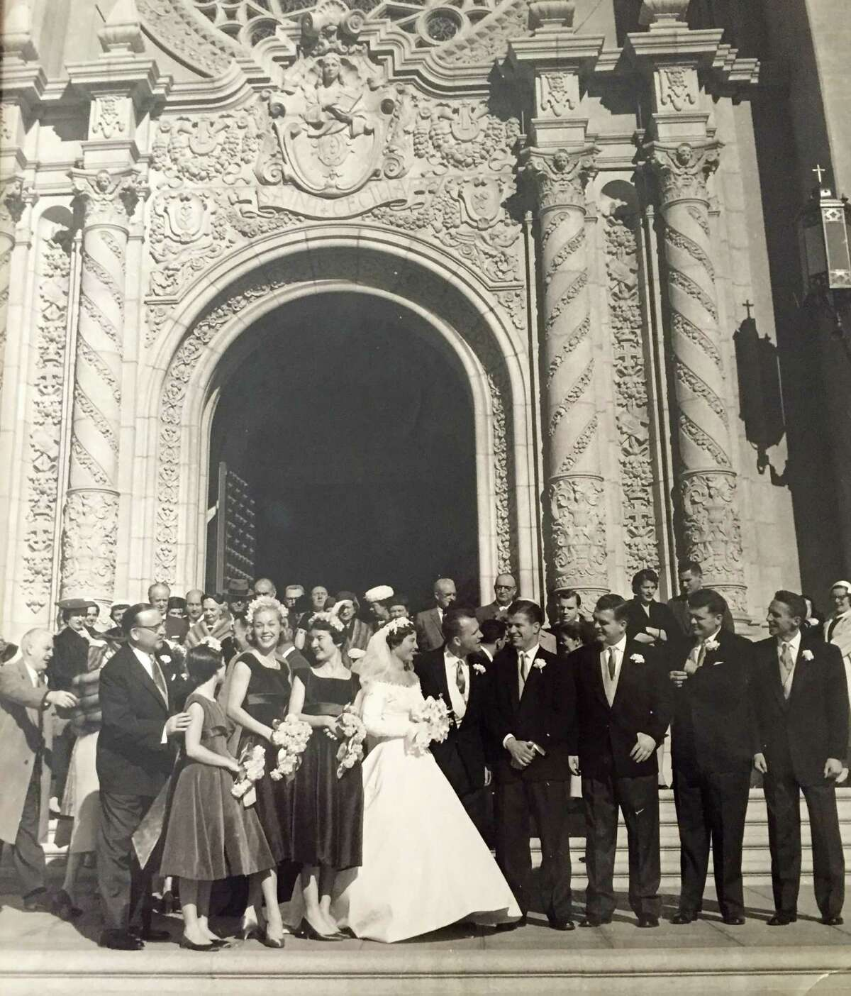Cynthia Brown Kelly on her wedding day, Jan. Jan 24,1957 in front of Saint Cecilia. Her father, Governor Pat Brown, is to her right, in glasses.