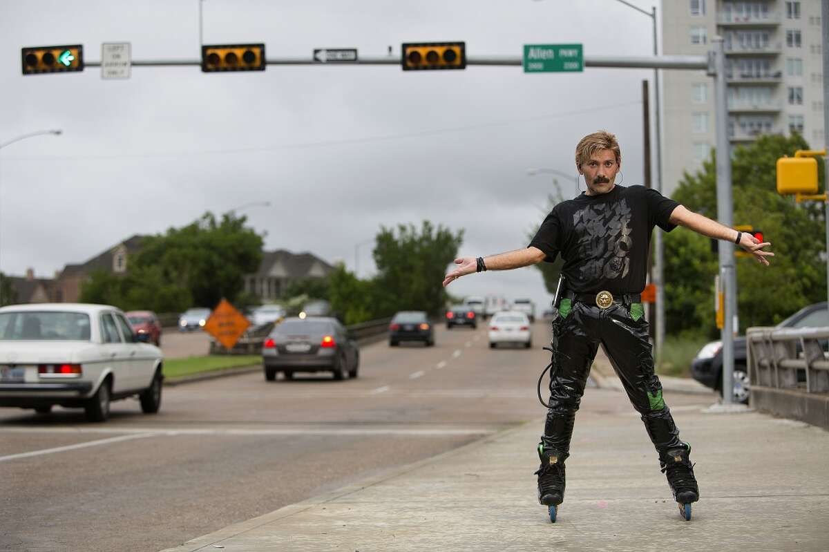 """Juan Carlos The """"Montrose Rollerblader"""" skate dances on the corner of Montrose and Allen Parkway during rush hour where he has entertained passersby for the past 15 years."""