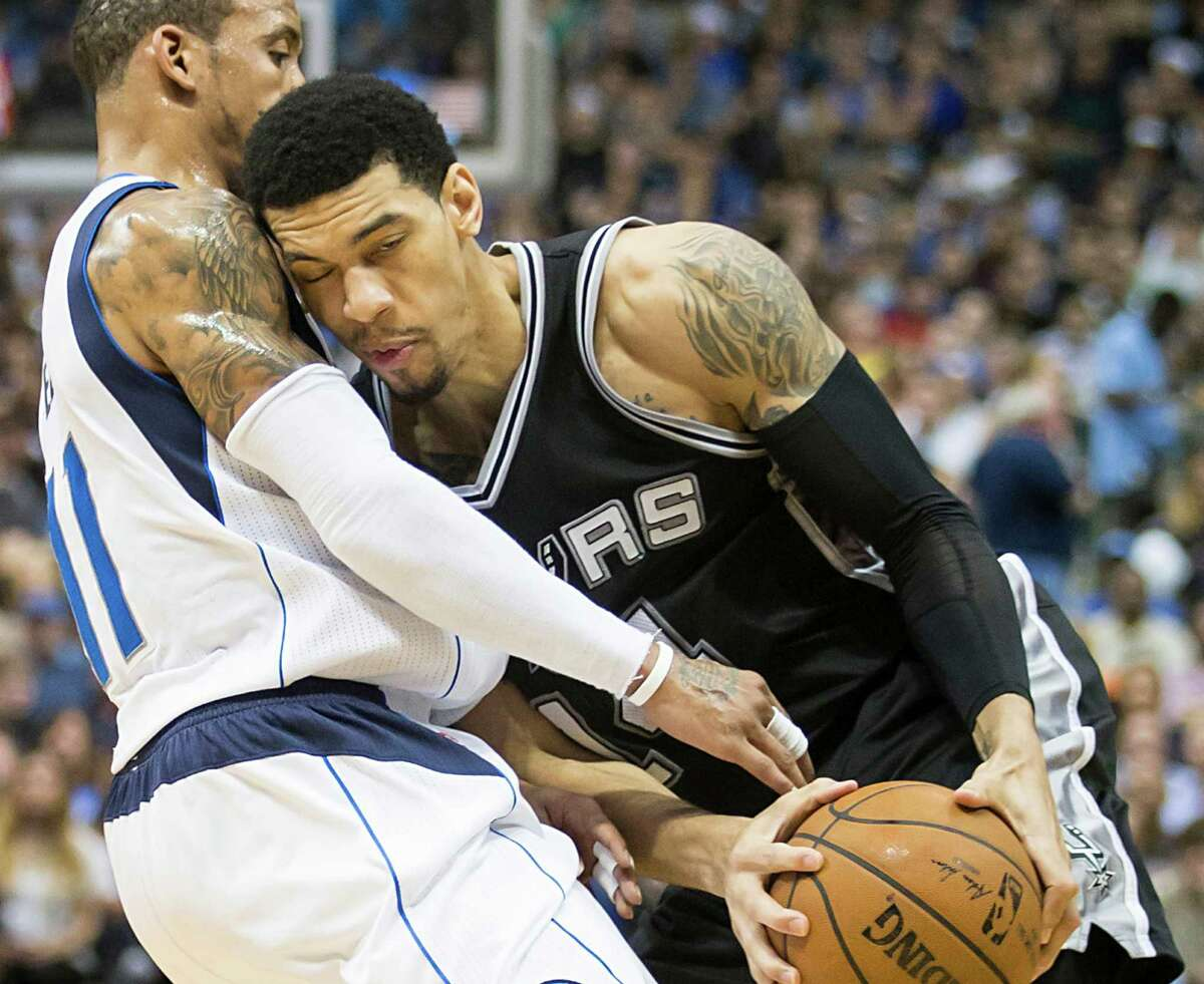 Mavericks guard Monta Ellis defends against Spurs guard Danny Green during the first half on March 24, 2015, in Dallas. The Mavericks won 101-94.