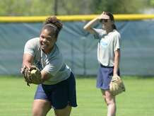 Sierra Miller stretches for the catch as teammates bat during practice Friday. With a six-game winning streak under their belt, the Lamar State College - Port Arthur softball team is poised for a bid in the Region XIV post-season tournament. Photo taken Thursday, March 26, 2015 Kim Brent/The Enterprise