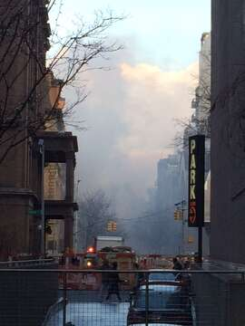Smoke hovers looking up Second Avenue toward the gas explosion in New York.