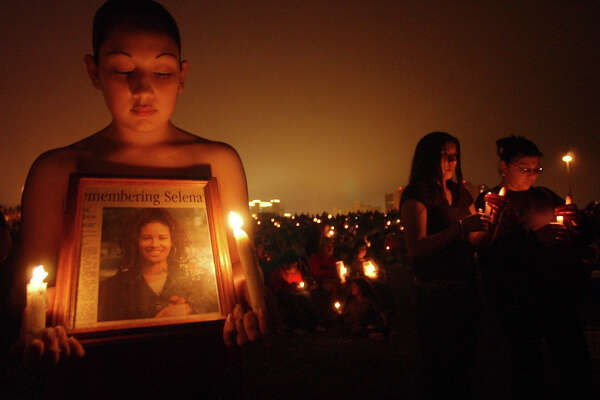 Monica Robles, 18 of Corpus Christi,takes part in a candle light vigil with hundreds of other fans for slain Tejano star Selena Thursday March 31, 2005 at Cole Park in Corpus Christi.