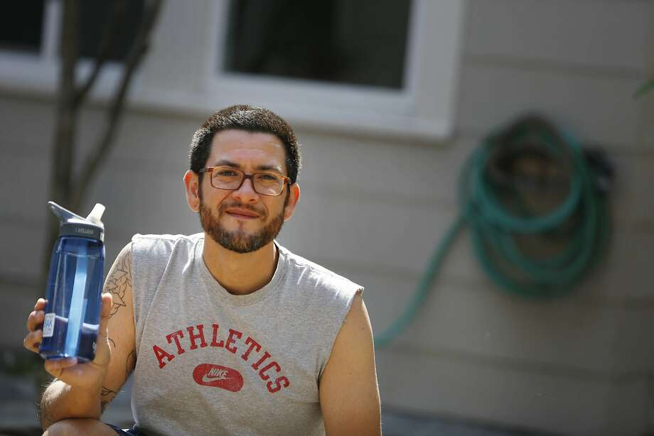 Justin Lagana-Jackson, Oakland resident in the Laurel district, poses for a portrait in the yard at his home on Monday, March 30, 2015 in Oakland, California.  Lagana-Jackson noticed a different taste in his water after drinking from a water bottle filled from the garden hose while working in his yard on Sunday. Photo: Lea Suzuki, The Chronicle
