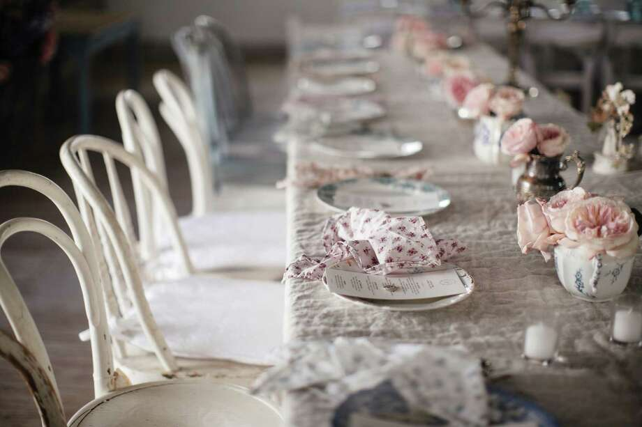 This table was dressed up in Shabby Chic style for a wedding reception in the barn of the Prairie, Ashwell's bed-and-breakfast in Round Top. Photo: Anne Marie