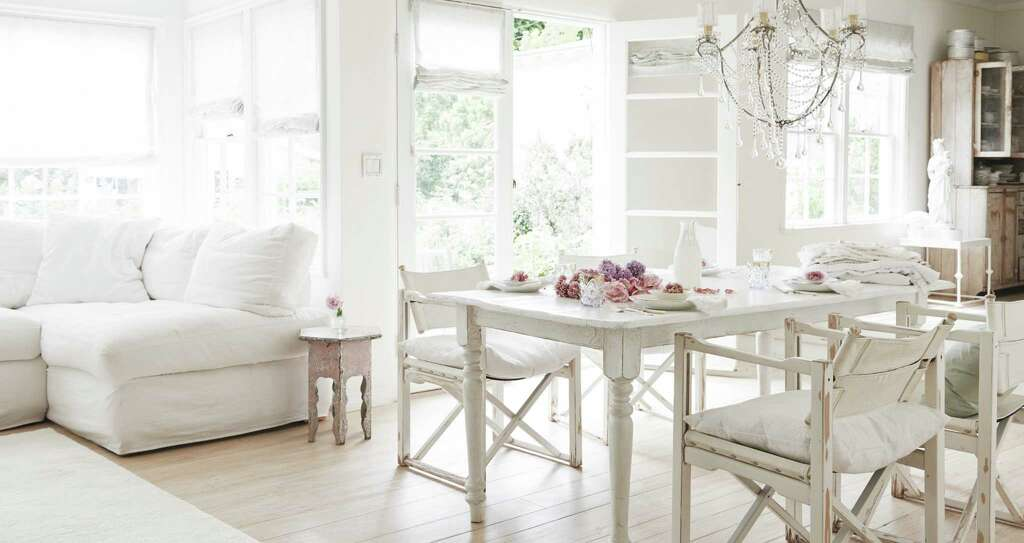 Rachel Ashwell's own home in California is outfitted in Shabby Chic decor. The table is simple and white. She found the folding chairs at a flea market and added soft cushions. Photo: Amy Neunsinger / © 2014 Amy Neunsinger
