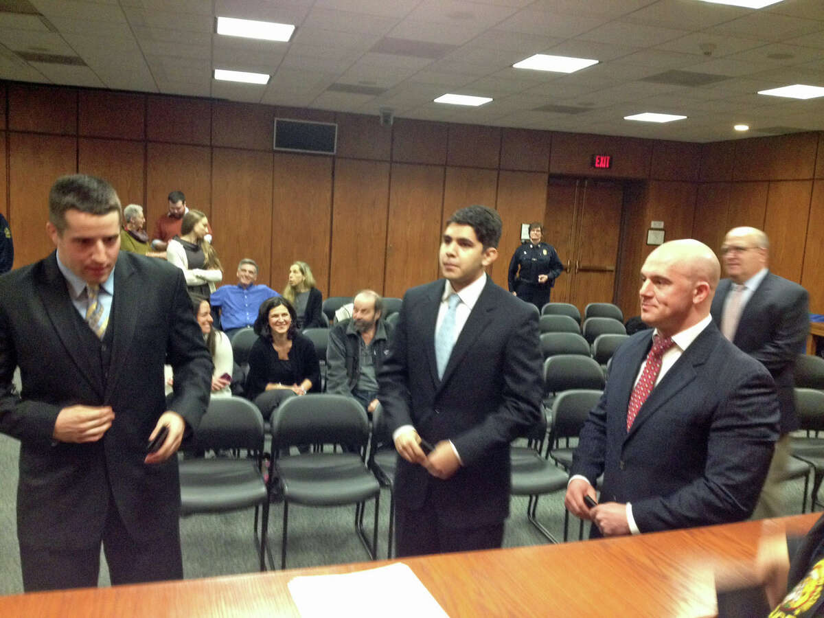 From left: Max Rinaldi, Sebastian Arenas and Justin Quagliani finish signing their names after being sworn in as Greenwich police officers at Town Hall.