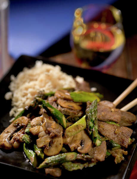 Asparagus, mushrooms and beef come together in a quick stir-fry. Photo: Bob Fila /Tribune News Service / Chicago Tribune