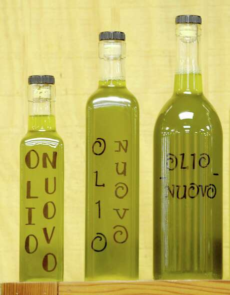 A sample of new-crop olive oils that Dave Lagnese sells at his California Connection stand at the Farmers' Market Coop of East Liberty, Pa. Photo: Pam Panchak /Tribune News Service / Pittsburgh Post-Gazette