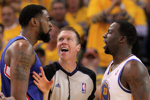 DeAndre Jordan (left) and Draymond Green exchange pleasantries during last year's first-round playoff series.