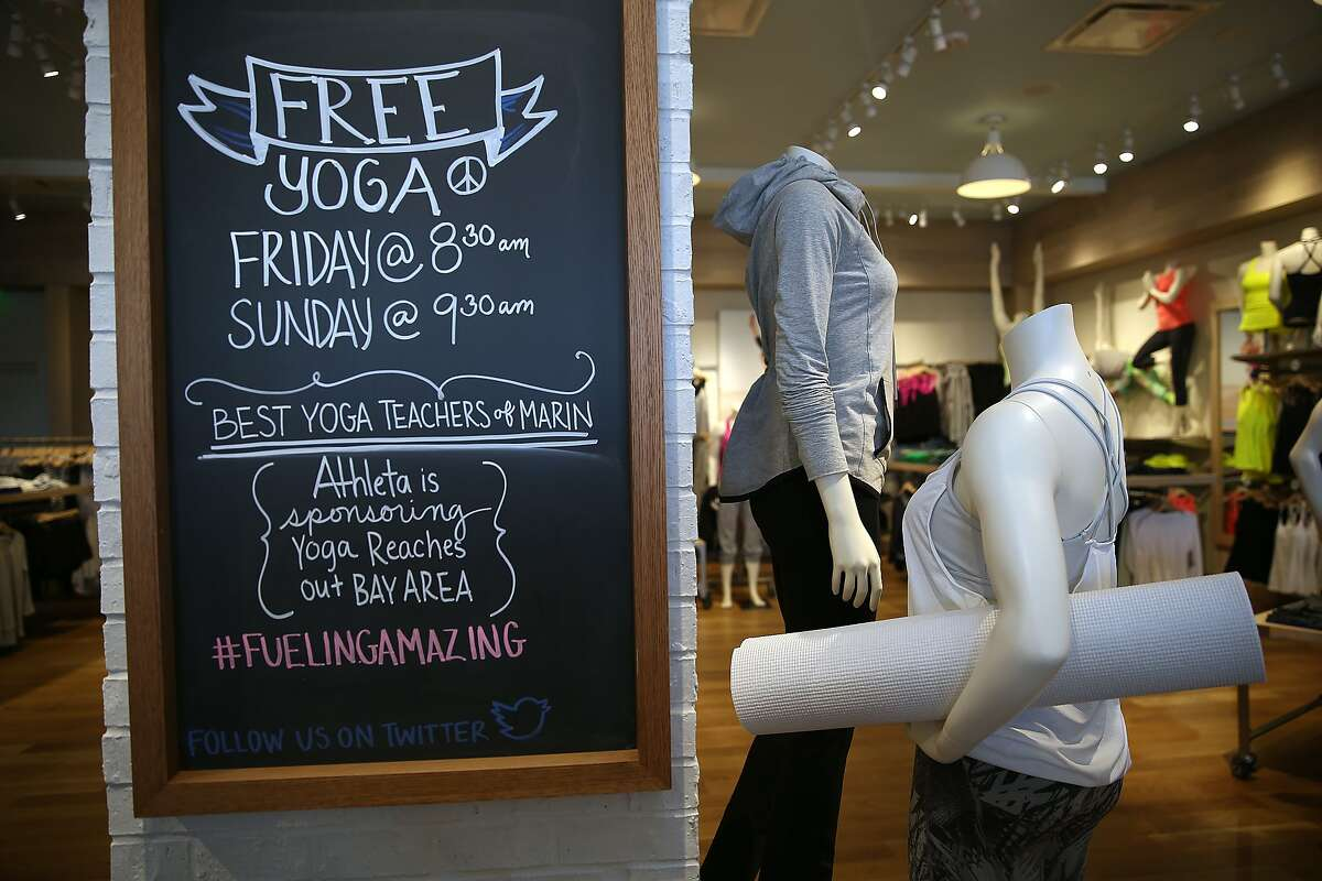 A chalkboard listing yoga classes for the week seen at Gap-owned Athleta brand, a women's activewear store in Corte Madera, California on Monday, March 30, 2015.