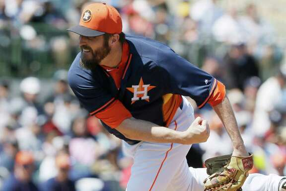 Houston Astros relief pitcher Chad Qualls throws during the fifth inning of a spring training exhibition baseball game against the New York Yankees in Kissimmee, Fla., Sunday, March 29, 2015. (AP Photo/Carlos Osorio)