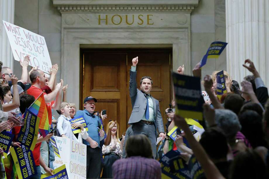 Rep. Warwick Sabin, D-Little Rock, center, leads protests Monday outside the House chamber at the Arkansas state Capitol in Little Rock, Ark. The state is considering a bill similar to the new law receiving backlash in Indiana. Photo: Danny Johnston, STF / AP
