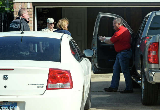The FBI, Friday morning, searched the homes of Naomi Lawrence Lee BISD's purchasing director and William 'Bo' Kelley the former West Brook Booster Club president. Kelley is greeted in his driveway by investigators. Photo taken Friday, April 04, 2014 Guiseppe Barranco/@spotnewsshooter Photo: Guiseppe Barranco, Photo Editor
