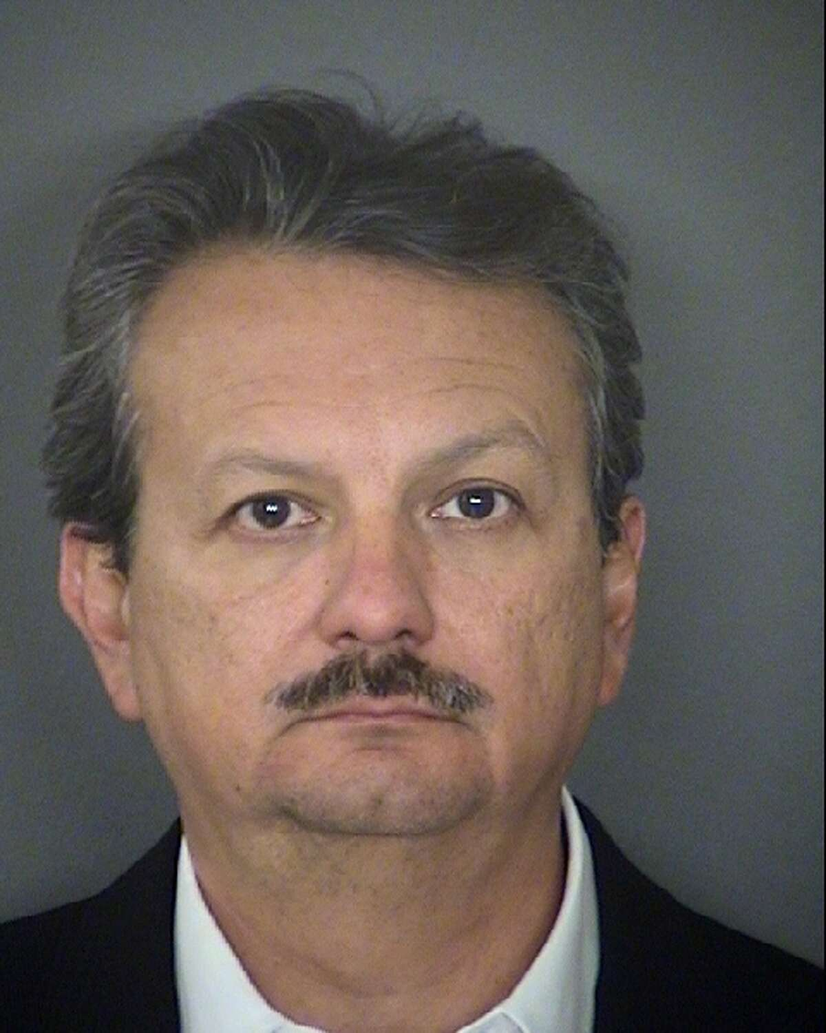 Ex-banker Armando Jesus Hernandez Leal, 53, is jailed in San Antonio on allegations that he stole $66 million he was supposed to invest.
