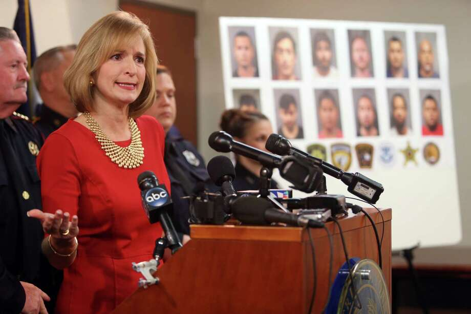 District Attorney Devon Anderson on Monday announces details of an undercover operation that led to the arrests and charges of 12 people for online solicitation of a minor from Wednesday to early Saturday. Photo: Mayra Beltran, Staff / © 2015 Houston Chronicle